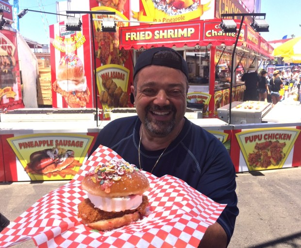 Charlie Baghosian shows off his latest fair creation: Krispy Kreme ice cream chicken sandwich. (Courtesy OC Fair)