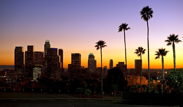 The sun sets beyond the Los Angeles skyline, as seen from Dodger Stadium in Los Angeles. The relocation of tech companies to southern California is part of a growing movement of U.S. cities seeking to duplicate the formula that turned northern California's Silicon Valley, slightly south of San Francisco, into a mecca of society-shifting innovation and immense wealth.