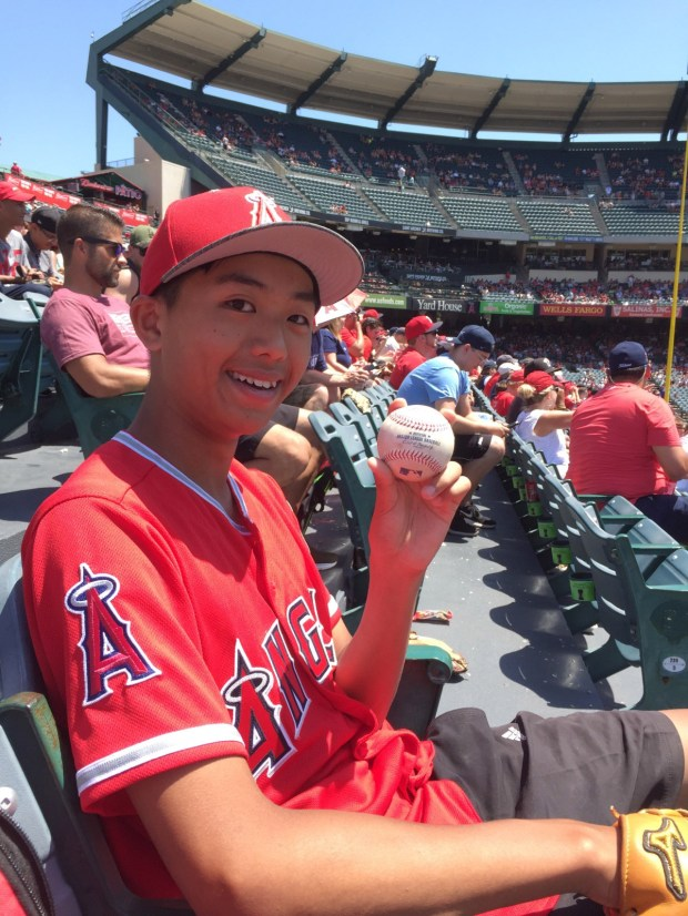 Angels fan Fergus Chan, of Hong Kong, caught Mike Trout's home run on Sunday, June 23. (Photo courtesy of Fergus Chan)