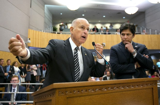 Gov. Jerry Brown, left, and Senate President Pro Tem Kevin de Leon, D-Los Angeles, address the Senate Environmental Quality Committee about extending the state's cap-and-trade program at a July 13 hearing.