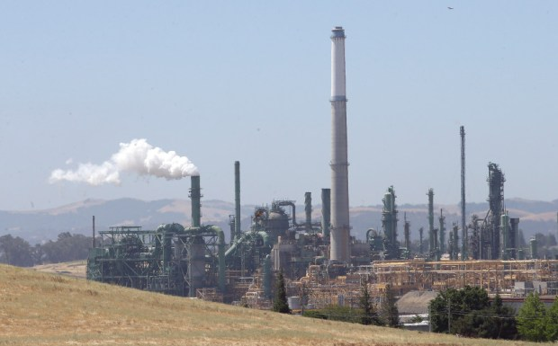 This file photo shows Valero's Benicia oil refinery. California's cap-and-trade program seeks to limit greenhouse gas emissions by selling pollution credits, the number of which gradually decline.