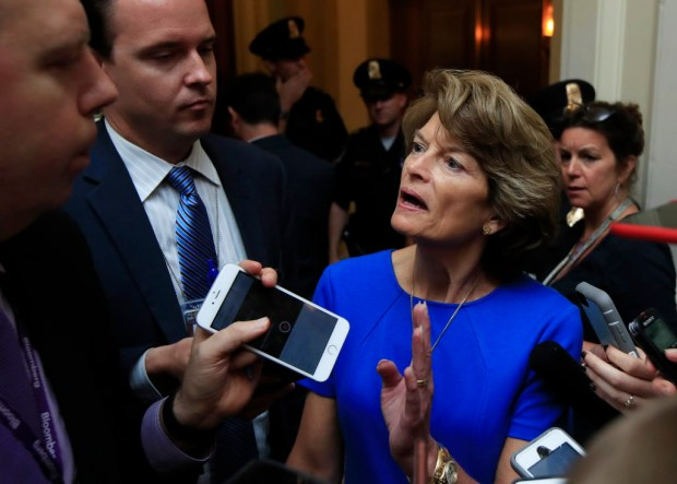 Sen. Lisa Murkowski, R-Alaska is surrounded by reporters as she walks toward the Senate floor on Capitol Hill in Washington, Tuesday, July 18, 2017. (AP Photo/Manuel Balce Ceneta)