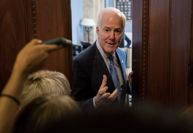 Senate Majority Whip John Cornyn of Texas talks to reporters outside his office on Capitol Hill in Washington, Wednesday, July 26. (AP Photo/Carolyn Kaster)