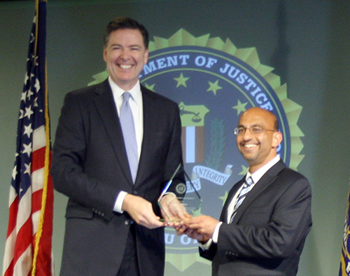 Then-FBI Director James Comey presents an FBI Director's Leadership Award to Fullerton's Omar Siddiqui in April 2016. Photo courtesy of Omar Siddiqui.