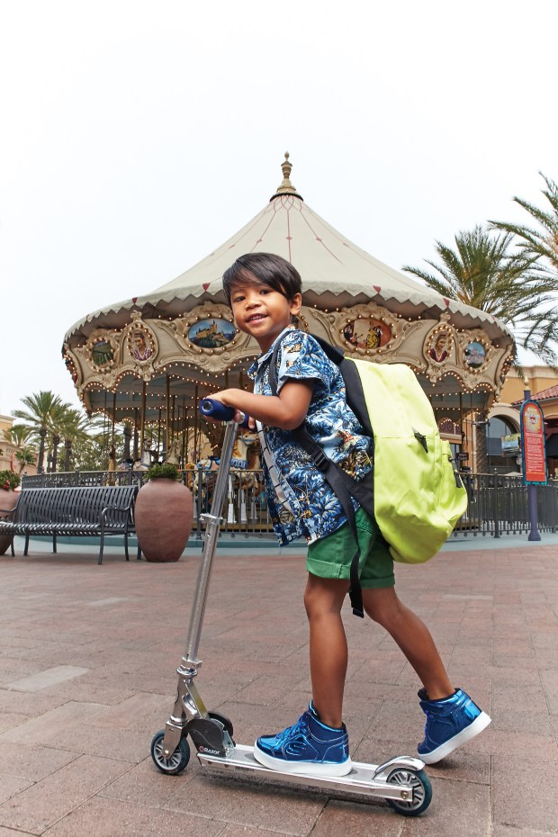 Marc Ner, 6, of Irvine maxes out cool and casual with his Razor and neon-bright backpack at Irvine Spectrum on June 22, 2017. (Photo by Ralph Palumbo, contributing photographer)