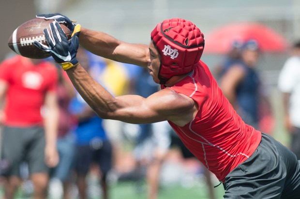 Mater Dei receiver Nikko Rimigio makes a catch along the sidelines against St. John Bosco during the Battle at the Beach seven on seven football tournament at Edison High School in Huntington Beach on Saturday, July 8, 2017. (Photo by Matt Masin, Orange County Register, SCNG)