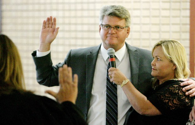 Riverside Ward 7 Councilman John Burnard with wife Kathy by his side is sworn in to office by The Honorable Cheryl C. Kersey, Superior Court Judge, San Bernardino County Tuesday in Riverside, June 30, 2015.