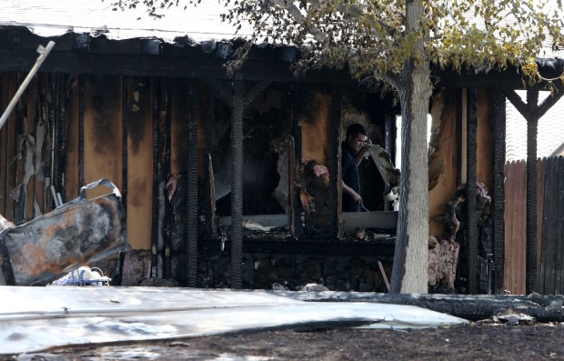 """A home in the 33000 block of East Harvest Way in Wildomar was destroyed early Wednesday, July 19, 2017, in an explosion and fire that also sent one person to the hospital and damaged a neighboring house. Sheriff's officials are investigating whether an illegal drug lab producing """"honey oil"""" was to blame. (Photo by Frank Bellino, The Press-Enterprise/SCNG)"""