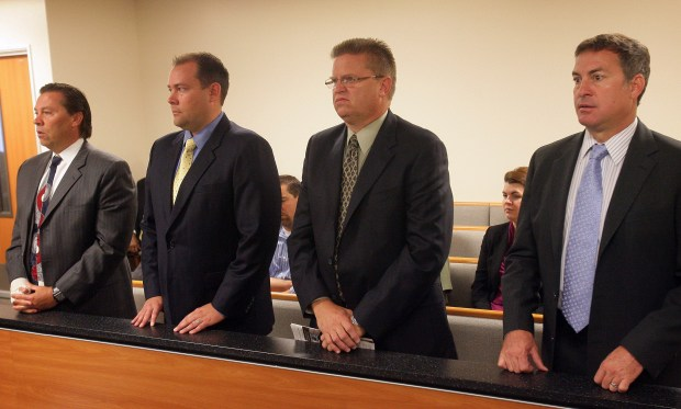 From left, developer Jeff Burum, Mark Kirk, former chief of staff to Supervisor Gary Ovitt. former assistant assessor Jim Erwin and former supervisor Paul Biane appear in San Bernardino County Superior Court in this June 2011 file photo. Five more charges were dropped against the defendants Tuesday, July 11, 2017. (David Bauman/The Press-Enterprise)