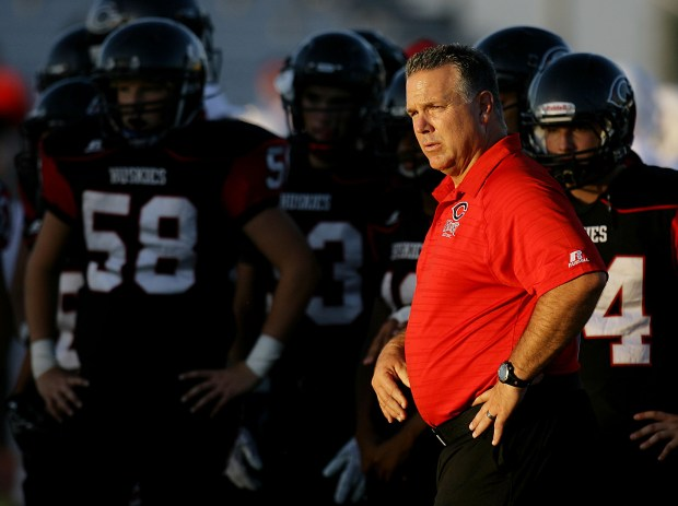 Corona Centennial head coach Matt Logan takes his team though warmups before playing Orange Lutheran in Corona, CA. Friday, Sep. 9, 2016. TERRY PIERSON,THE PRESS-ENTERPRISE/SCNG