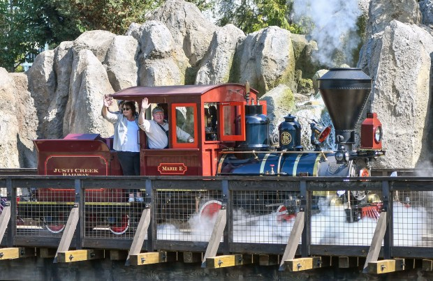 John Lasseter is at the controls of his own steam locomotive, the Marie E, as he drives over the new trestle bridge that separates Frontierland's Rivers of America from Star Wars: Galaxy's Edge at Disneyland, on Friday, July 28, 2017. Disneyland reopened the Disneyland Railroad, the Mark Twain Riverboat, Sailing Shop Columbia and Davy Crockett Explorer Canoes after rerouting the Rivers of America for Star Wars: Galaxy's Edge. (Photo by Jeff Gritchen, Orange County Register/SCNG)