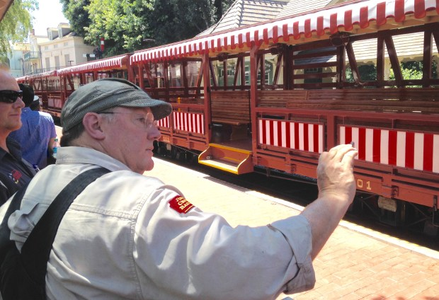 John Lasseter, chief creative officer for Walt Disney Animation and PIXAR, is a real rail fan, and shoots video of the Disneyland Railroad train as it pulls into the New Orleans Square station at Disneyland. Lasseter also owns a steam locomotive, the Marie E, that was once owned by Ollie Johnston, one of Walt Disney's nine-old-men of animation. The Marie E was on the tracks of the Disneyland Railroad when it reopened after an 18-month closure. It was pulling the Chloe, owned by Ward Kimball, another one of Walt's nine-old-men. (Photo by Mark Eades, Orange County Register/SCNG) Taken in Anaheim at Disneyland on Friday, July 28, 2017.