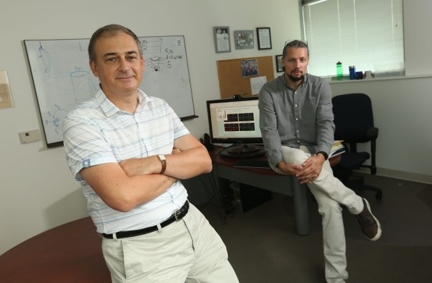 Mathematician Mark Alber, left, and bioengineer Oleg Kim have identified a mechanism that blocks a protein that allows ovarian cancer cells the metastasize. The hope is that drugs might be developed using the blocking mechanism.(Stan Lim, The Press-Enterprise/SCNG)