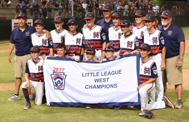 Santa Margarita Little League team members hold up their West Championship flag.(Photo by Bill Alkofer, Orange County Register/SCNG)