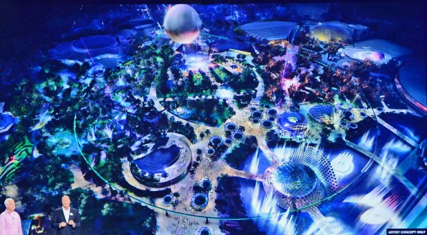 An artist's concept painting of changes announced for Epcot at Walt Disney World in Florida. The changes shown here are primarily in the center of the Future World area of Epcot around the area that was known as Communicore when the park opened in 1982, then the name was changed in the 1990s to Innoventions. The plan is to tear down the large concrete buildings and make that are more park-like with a multitude of fountains and plants. In the lower left hand corner are Tom Fitzgerald, portfolio executive for Walt Disney Imagineering (left) and Bob Chapek, chair of Walt Disney Parks & Resorts. They made the announcement about the changes at the 2017 D23 Expo held in July 2017 in Anaheim. (Courtesy, Walt Disney World Resort)