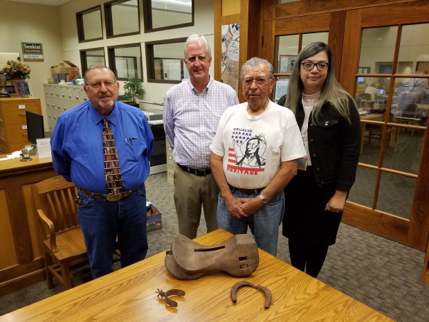 From left to right, historians Michael Miniaci and Douglas Westfall, researcher Eddie Grijalva and archivist Lizeth Ramirez pose with three new artifacts showing Orange's history as part of the Rancho Santiago de Santa Ana. (By Jonathan Winslow, staff)