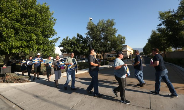 Members of the United Steelworkers unions and workers from American Medical Response (AMR), hold a protest outside AMR's office in Redlands on Tuesday, Aug. 2017. The union is currently in contract negotiations with AMR.(Stan Lim, Redlands Daily Facts/SCNG)