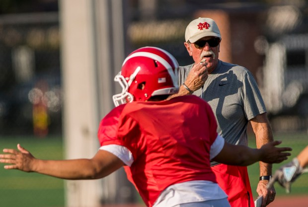 Mater Dei High School football coach Bruce Rollinson watches his players as they run through drills during practice in Santa Ana on Tuesday, August 29, 2017. (Photo by Paul Rodriguez, Orange County Register/SCNG)