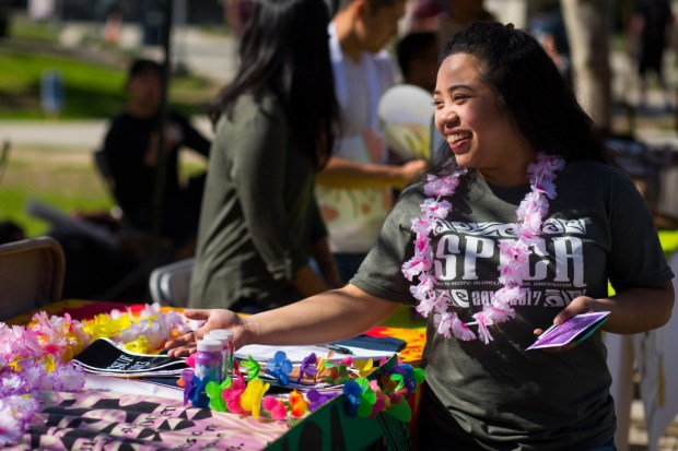 Sheremiah Alba welcomes visitors to the South Pacific Islander Cultural Association table at Discoverfest in February. (Photo by Foster Snell, contributing photographer)