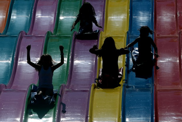 A group of children fly down the Euroslide on opening day of the L.A. County Fair at Fairplex in Pomona Friday September 2, 2016. (File photo by Will Lester/SCNG-INLAND VALLEY DAILY BULLETIN)
