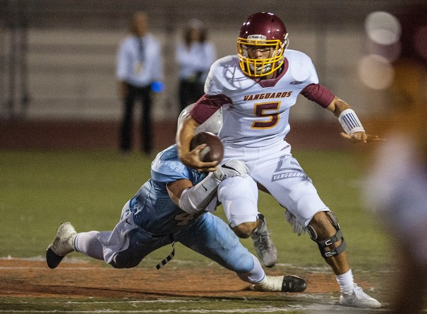 El Modena quarterback AJ Esperanza gets sacked during a game against Villa Park at Fred Kelly Stadium in Orange on Friday, September 23, 2016. (Photo by Nick Agro, Orange County Register/SCNG)