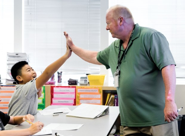 Math teacher Mark Boehning, right, gives a student a high-five after getting a correct answer at New Vista School in Laguna Hills on Thursday, July 27, 2017. (Photo by Leonard Ortiz, Orange County Register/SCNG)