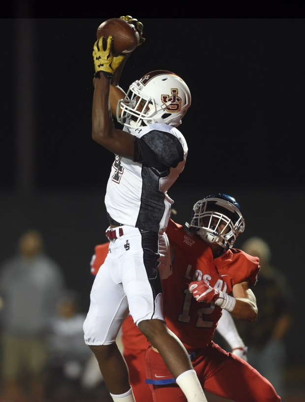 JSerra Catholic's Tarik Luckett,4, makes the catch for a touchdown against Los Alamitos's Mike Magana ,12, during the 1st quarter at Veterans Memorial Stadium. Long Beach Calif., Saturday, September,22, 2016. (Photo by Stephen Carr / Daily Breeze/SCNG)