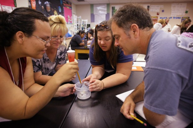 Valerie Sanchez, Erika Fatten, Karen Pope, and Emerson Treacy, left to right, observe their experiment during a training session for Riverside Unified teachers at Central Middle School on Tuesday, August 2, 2016. Inland teachers have been busy this summer getting trained on the new state science standards that are being rolled out across California. Like the Common Core math and English standards, the more rigorous science requirements teach critical thinking rather than memorization.