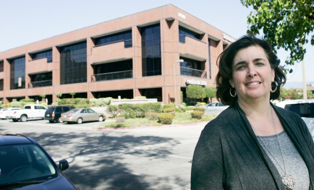Kathleen Hermsmeyer, superintendent of Springs Charter Schools, stands in front of a Temecula office building in 2016 that the school converted to a charter school.