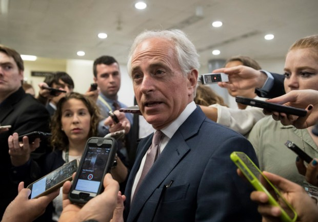 "In this July 27, 2017, Senate Foreign Relations Committee Chairman Sen. Bob Corker, R-Tenn. is surrounded by reporters on Capitol Hill in Washington. Corker, the chairman of the Foreign Relations committee and a foreign policy ally of the Trump White House, delivered the sharpest criticism of Trump, declaring that the president ""has not yet been able to demonstrate the stability nor some of the competence that he needs to"" in dealing with crises. (AP Photo/J. Scott Applewhite, File)"