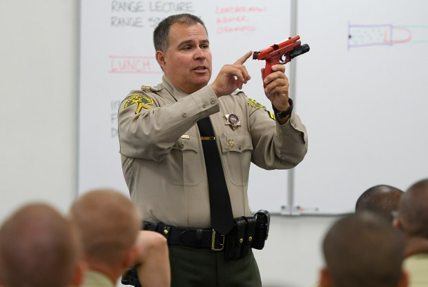 Deputy Lee Leatherman teaches Sheriffs Academy recruits during classroom weapons training . Los Angeles 6/15/2017 Photo by John McCoy/Los Angeles Daily News (SCNG)