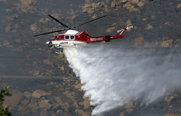 A helicopter drops water on the Blaine fire in the Box Springs Mountains between Riverside and Moreno Valley on Sunday, Aug. 13, 2017. (Photo by Will Lester, The Press-Enterprise/SCNG)