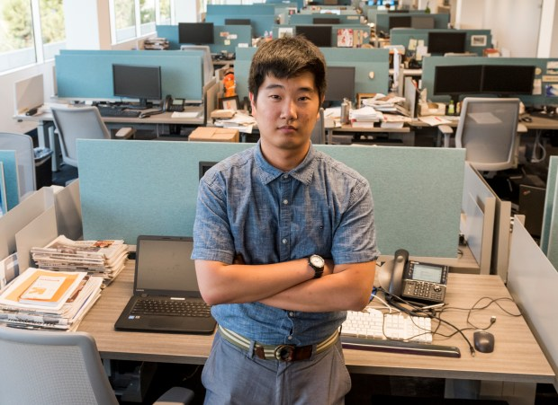 Journalism intern Jeong Park in the newsroom at the Orange County Register Anaheim on Friday, September 1, 2017. Park, 23, a Korean immigrant and a DACA recipient who came to the United States when he was 11-years-old. Park graduated from UCLA with a political science major. (Photo by Leonard Ortiz, Orange County Register/SCNG)