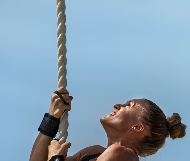 Sally Brink Of Orange Climbs A Rope During The Orange County Sheriffs Womens Fitness Challenge In