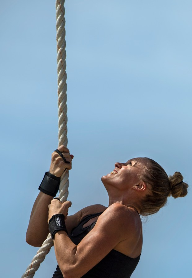 Sally Brink of Orange climbs a rope during the Orange County Sheriff's women's fitness challenge in Tustin in April. The event was for women in law enforcement, potential recruits and others like Brink who is a teacher.Photo by Mindy Schauer, Orange County Register/SCNG