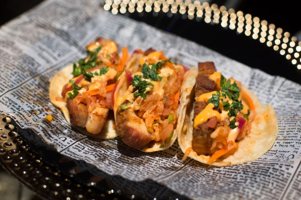 Dragon Breath Tacos feature pork belly, Korean BBQ sauce, kimchi slaw and sriracha aioli available at Disney California Adventure on Friday, September 15, 2017. (Photo by Drew A. Kelley, Contributing Photographer)