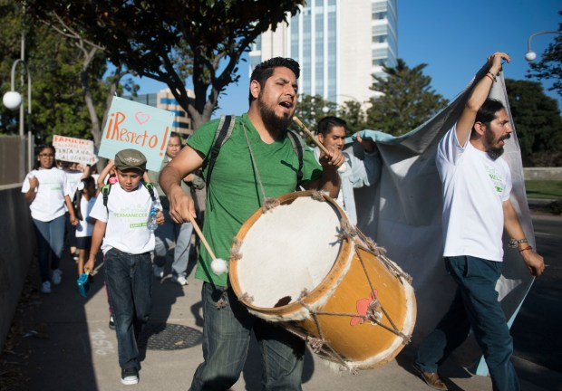 Drummer Moises Vazquez, center, and Luis Sarmiento, at right, lead a march through the streets of Santa Ana, part of the National Renter Rights Week of Action, in Santa Ana, CA on Tuesday, September 19, 2017. (Photo by Kevin Sullivan, Orange County Register/SCNG)