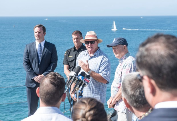 Ian Cairns discusses Shark Mitigation Systems' Clever Buoy, a shark detection system. at Corona del Mar State Beach in Newport Beach on Friday, September 22, 2017. (Photo by Nick Agro, Orange County Register/SCNG)