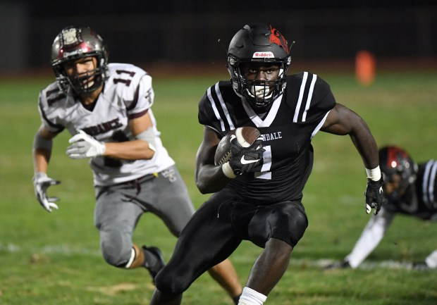 Lawndale running back Jordan Wilmore (1) carries the ball for a touchdown in first-half play against Torrance at Lawndale High School Friday evening.Photo for The Daily Breeze by Axel Koester, 09/29/2017.
