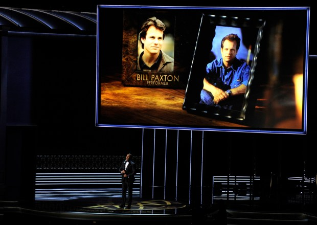 Christopher Jackson sings as a picture of Bill Paxton appears onscreen during an in memoriam tribute at the 69th Primetime Emmy Awards on Sunday, Sept. 17, 2017, at the Microsoft Theater in Los Angeles. (Photo by Chris Pizzello/Invision/AP)