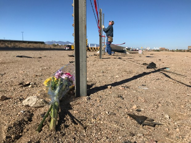 Flowers lie where a car crashed into the California Aqueduct in Hesperia on Friday, Sept. 16. Photo by Sarah Alvarado, Contributing Photographer