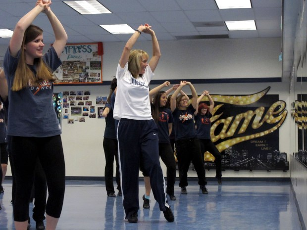 Kerri Fenton, in white, teaches dance at Cypress High School. (Photo by Yvette Cabrera, Orange County Register)