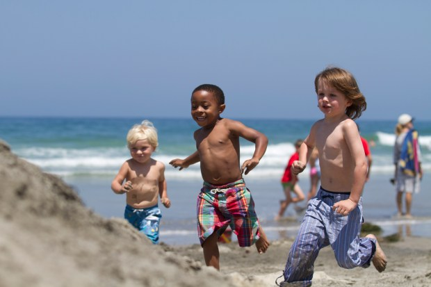 Kids on the beach in La Jolla. Courtesy of SanDiego.org.