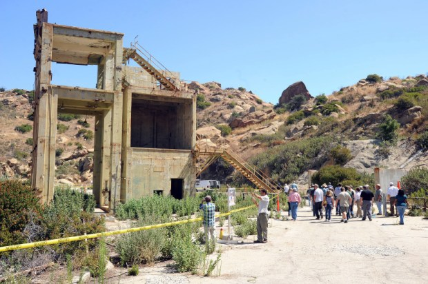 Visitors make their way by the remains of VTS-1 at the Santa Susana Field Lab Thursday, August 12, 2010.