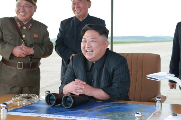 "In this undated file photo distributed on Saturday, Sept. 16, 2017, by the North Korean government, North Korean leader Kim Jong Un, center, attends what was said to be the test launch of an intermediate range Hwasong-12 missile at an undisclosed location in North Korea. Kim is calling President Donald Trump ""deranged"" and says in a statement carried by the state news agency that he will ""pay dearly"" for his threats. The statement, carried by North's official Korean Central News Agency, responds to Trump's combative speech at the U.N. General Assembly on Tuesday, Sept. 19. (Korean Central News Agency/Korea News Service via AP, File)"