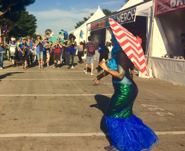 Mermaid Jerica Bornstein is part of a New Orleans style parade at Music Tastes Good. Photo by Richard Guzman