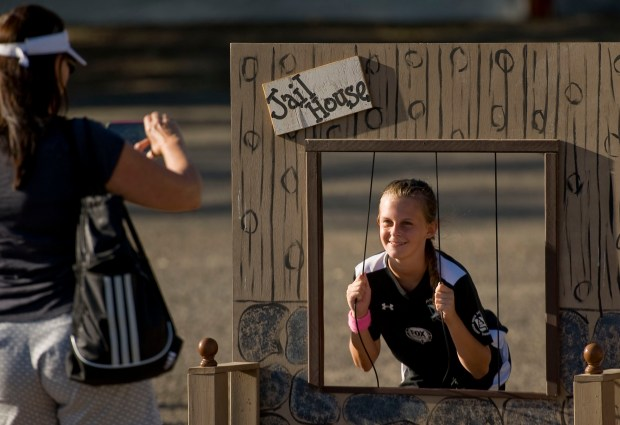 Regan Gibson, 10, of Aliso Viejo has her photo taken at the jail house by her mother, Janet, during the Aliso Viejo Founder's Day event on Saturday at Aliso Viejo Ranch in 2015. (Paul Rodriguez, file photo)