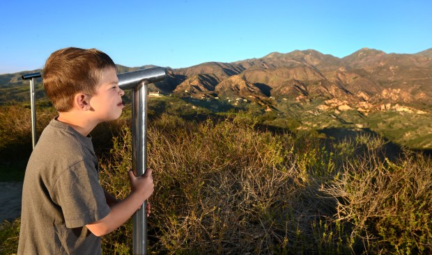 Casey Weatherbee, 7, of Los Angeles takes a look at Santiago Peak through a scope located on Vista Point in O'Neill Regional Park. (File Photo by BILL ALKOFER, - ORANGE COUNTY REGISTER/SCNG)