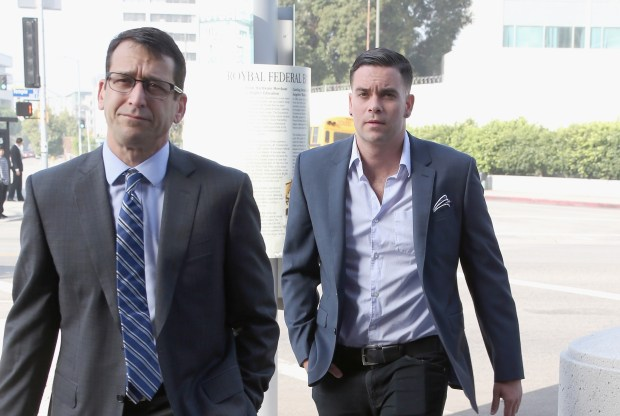 "Mark Salling, right, arrives for a court appearance at on June 3, 2016 in Los Angeles. The actor, who played Noah ""Puck"" Puckerman on ""Glee,"" has agreed to plead guilty to a federal child porn charge and will serve at least four years in prison, it was revealed on Oct. 4, 2017. (Photo by Frederick M. Brown/Getty Images)"