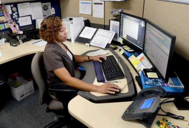 Office assistant Kathleen Taylor works at her desk at the San Bernardino County Department of Behavioral Health office in San Bernardino, Ca., Friday, October 6, 2017. San Bernardino County has deployed crisis response teams to support survivors and families of people killed and stepped up hotline staffing after an increase in calls, while Riverside County's behavioral health department can make such teams available.(Photo by John Valenzuela/Press Enterprise/SCNG)